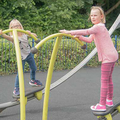 Kids playing on playground equipment in Heaton Close.jpg