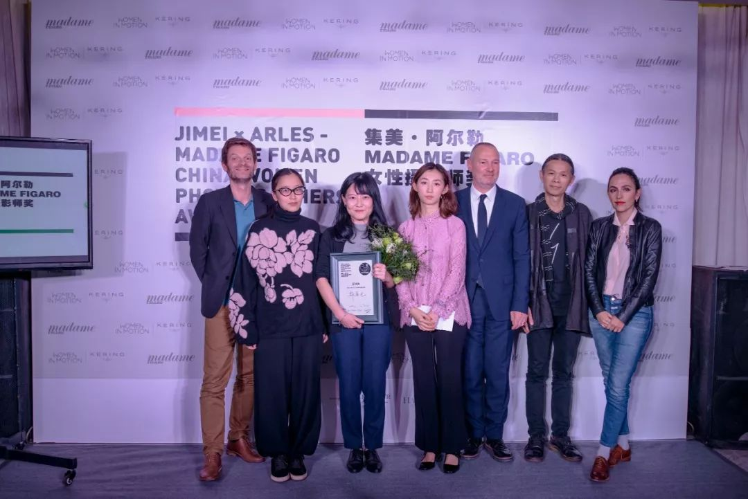 Jimei x Arles - Madame Figaro China Women Photographers Award ceremony. From left: Sam Stourdzé (director of Rencontres d'Arles and co-founder of Jimei x Arles, jury member), Ms Min (fashion designer & jury member), Guo Yingguang (winner), Liu Feifei (chief editor of Madame Figaro China), Jean-Luc Breysse (chief editor of Madame Figaro France), RongRong (artist, co-founder of Jimei x Arles and jury member), Anais Martane-Liu (artist & jury member)