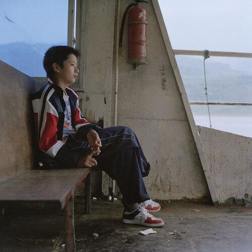 Liu Ke,  Boy on Ferry , 2008, Archival Inkjet Print. Courtesy of the artist.