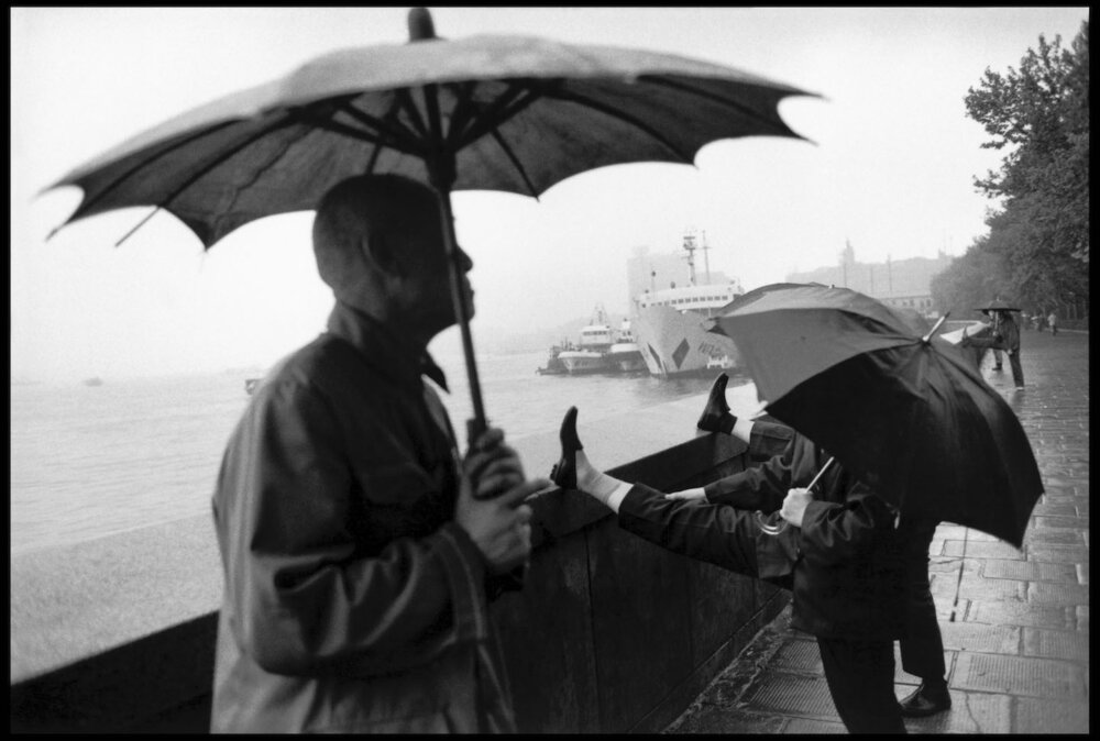 Guy Le Querrec,  Morning stretching on the Bund, Shanghai, 13 May 1984.  Courtesy of the artist / Magnum