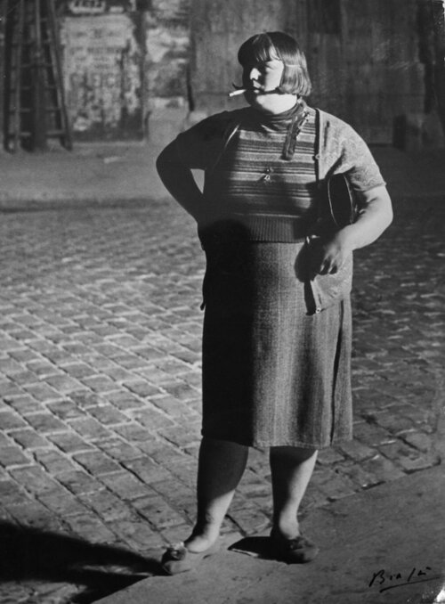 Brassaï,  Streetwalker, Quartier Italie,  Paris, c. 1932. Gelatin silver print, 29.5 x 22 cm. Courtesy of The Museum of Photography, Seoul.