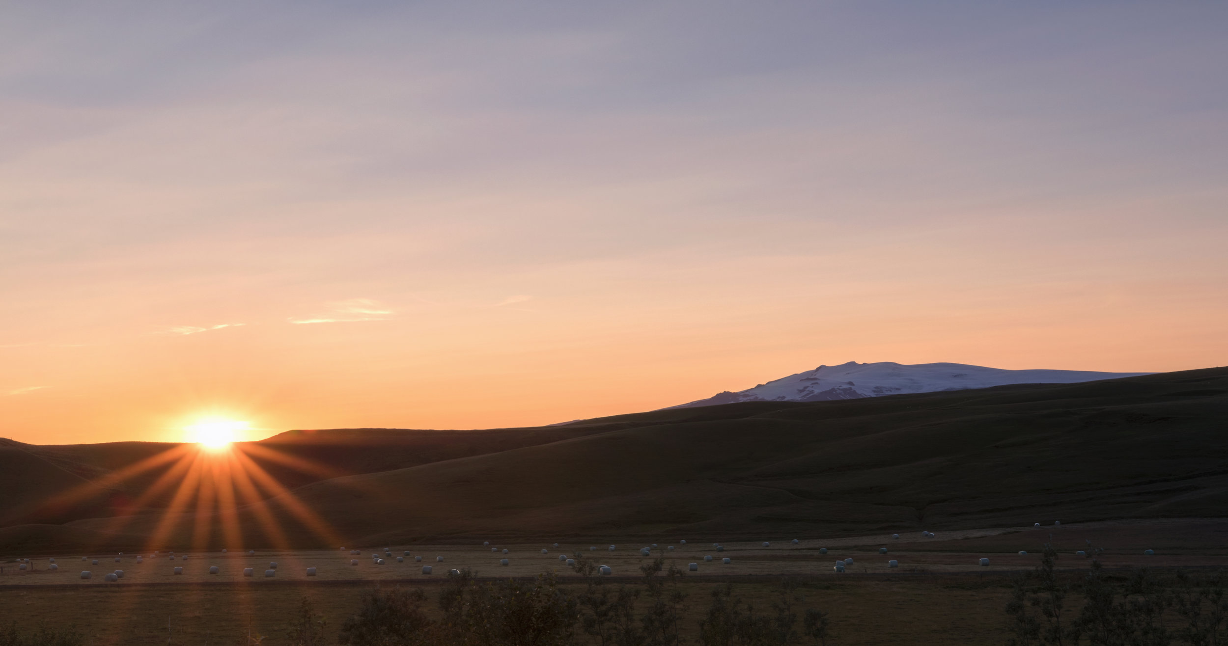 Taken just before 10pm in August from our family's summer house you can just see the famous Eyjafjallajökull volcano. I used the Photographer's Ephemeris to plan for the sun hitting that spot so I could capture it.