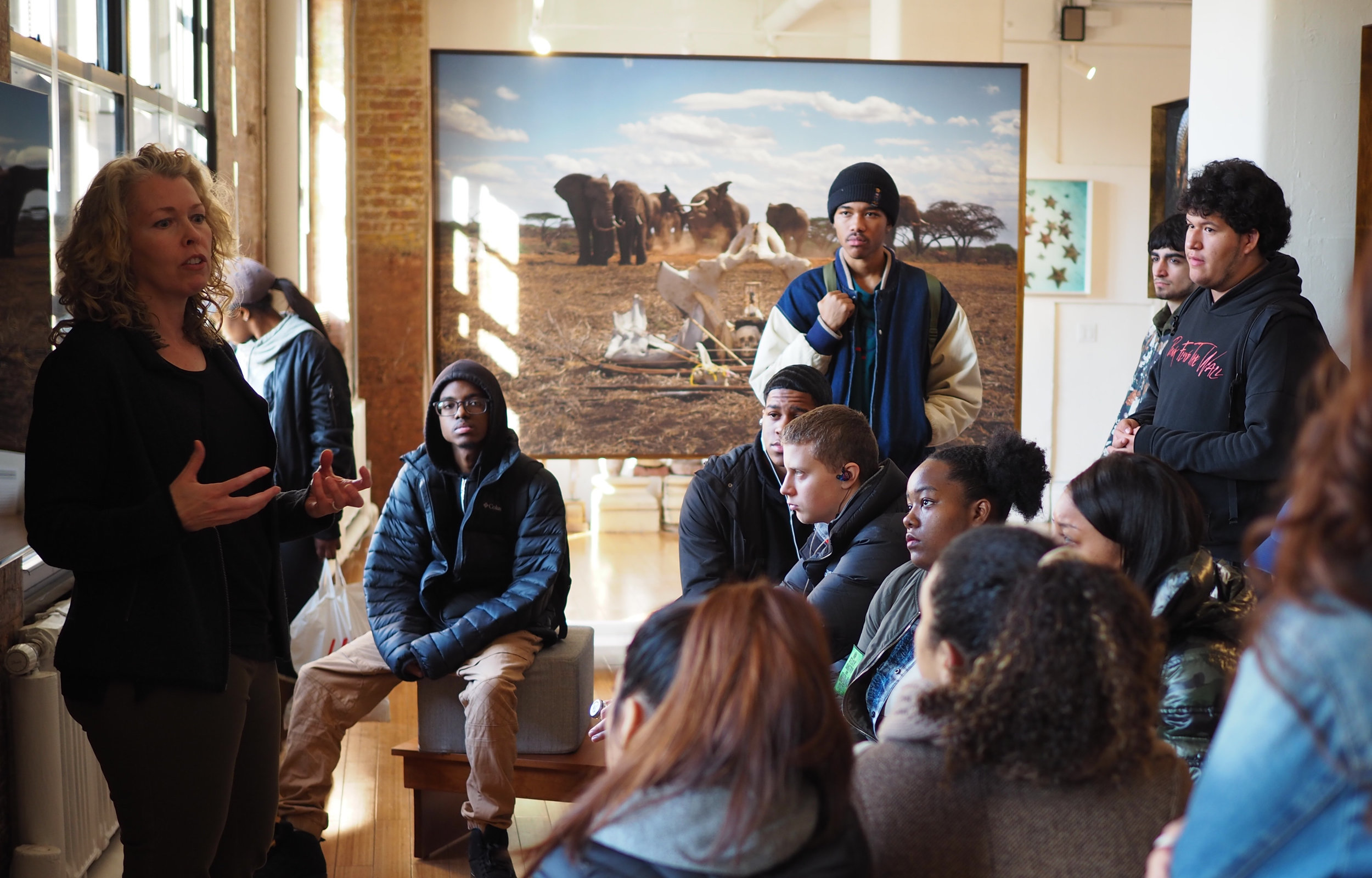 Climate Change Outreach to High School Students - Sustainability and resilience discussions at One Planet One Future's climate change gallery with Anne de Carbuccia.