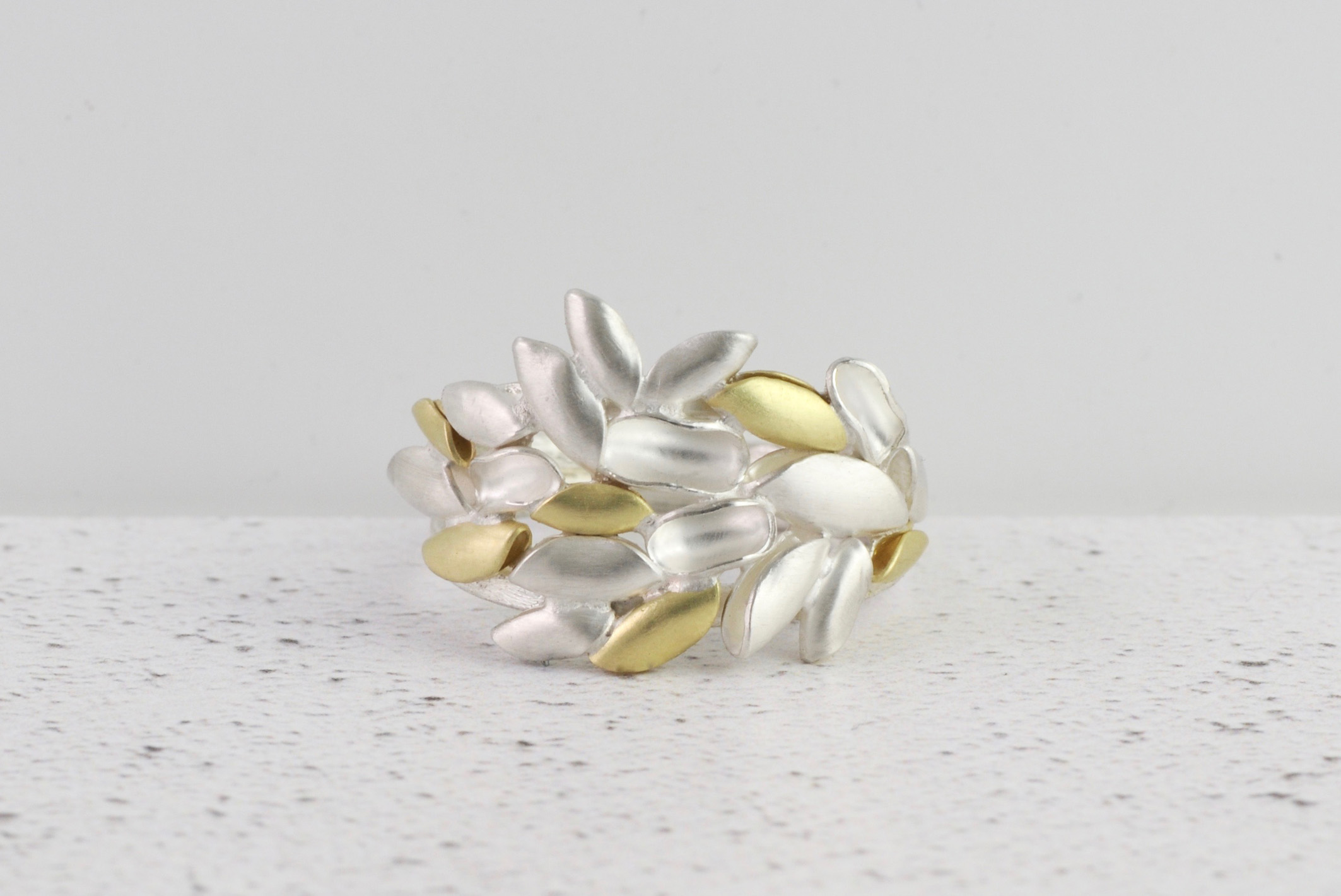 Silver and 18ct gold eden ring.jpg