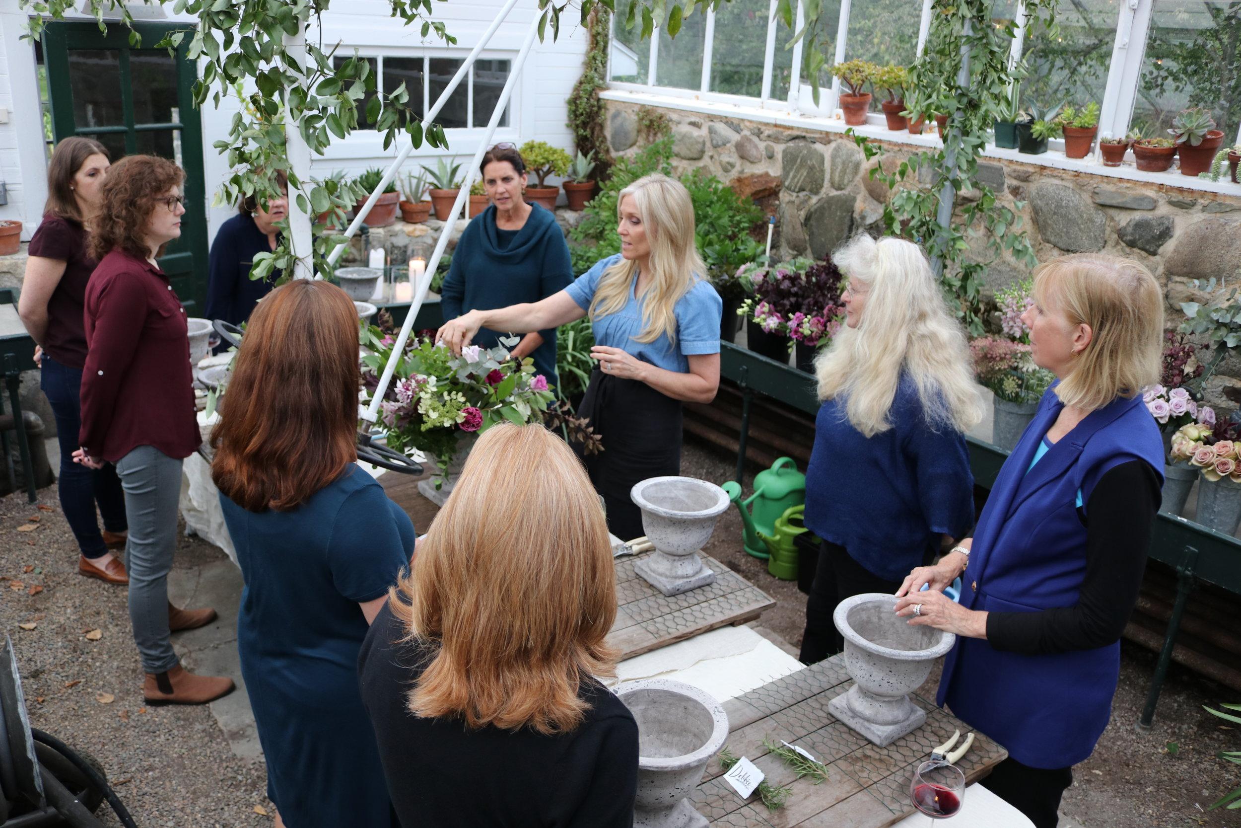 Sandra Sigman teaches floral design workshop in estate greenhouse