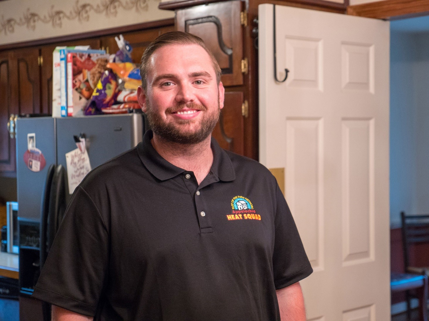 Appalachia HEAT Squad Relationship Manager Tyler Johnson on site during an AHS energy audit.