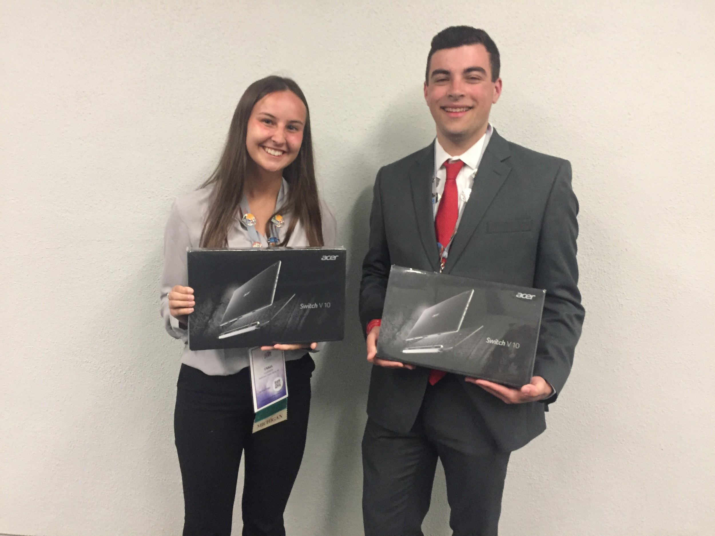 Emma Lussier and Jared Azevedo, Sault Area Career Center, displays national champion Microsoft certification prizes (2019 NLC)