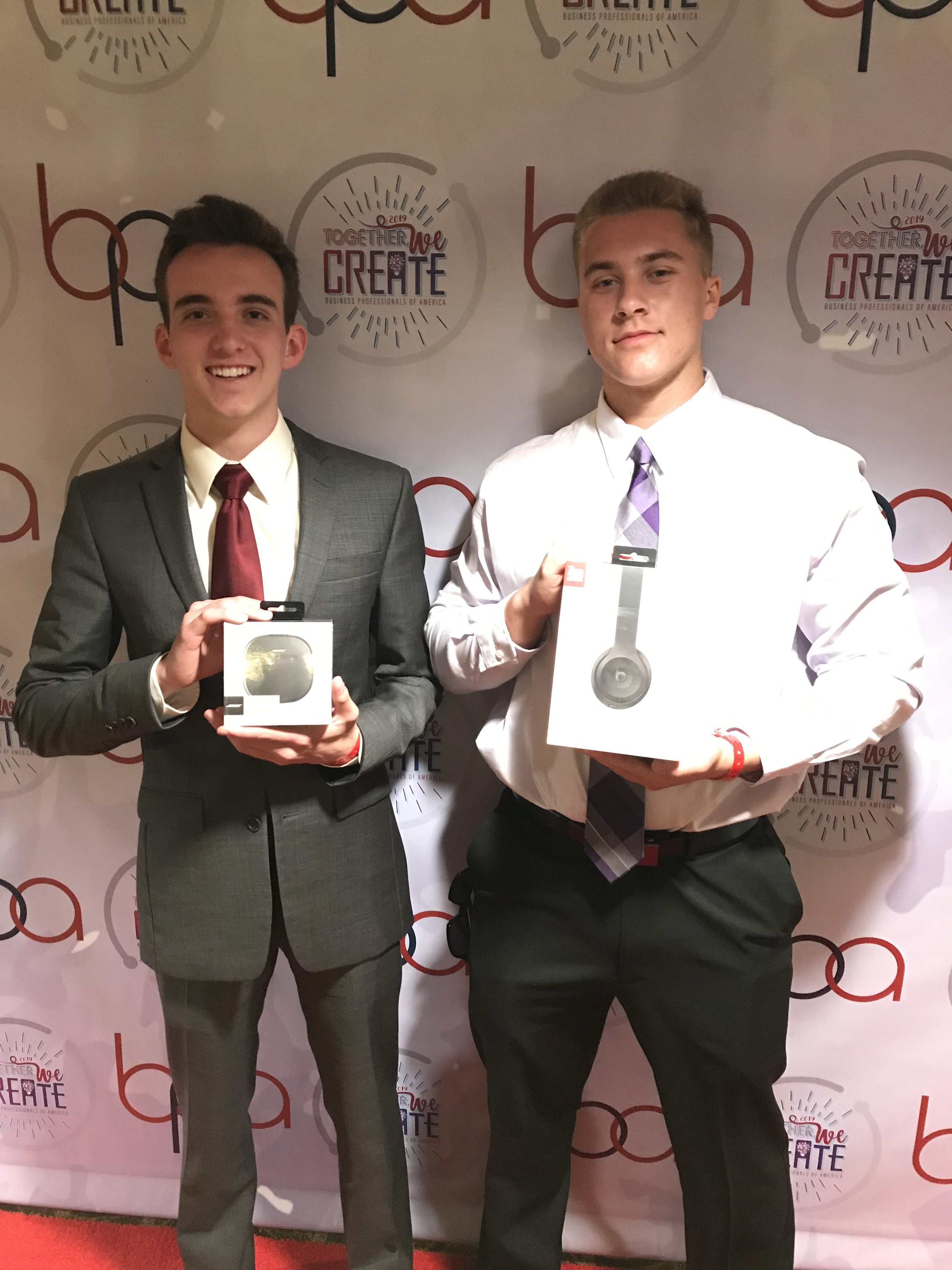 Matthew Miller and Nicholas Browning, Chippewa Valley HS, displaying their national prizes (2019 NLC)