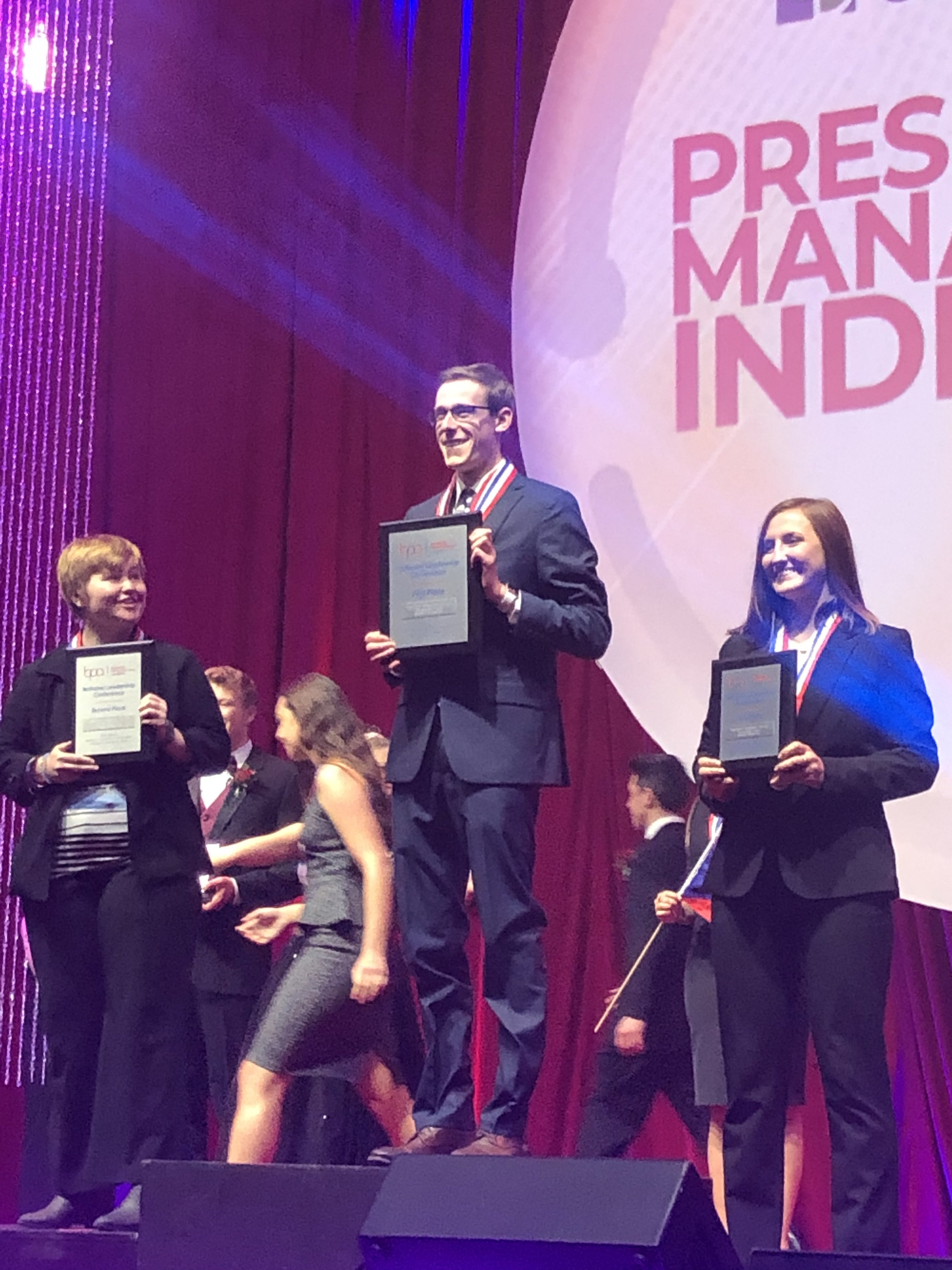 Presentation Management Individual (PS) - Jon Perrault, Northwood University (1st place, center), Jessica Ruby, CMU (3rd place, right) (2019 NLC)