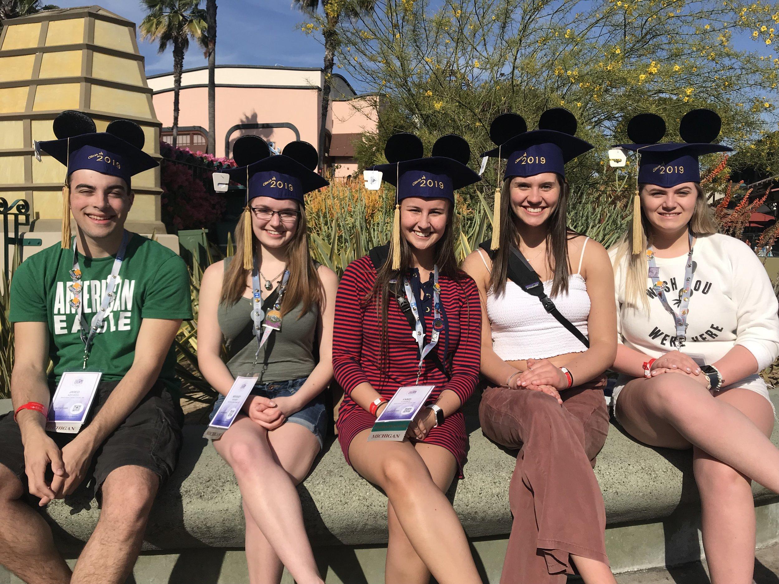 Sault Area Career Center 2019 graduates display their Mickey ears (2019 NLC)