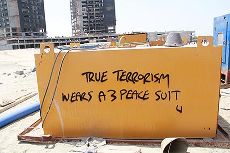 True terrorism wears a 3 peace suit by Arcadia Blank