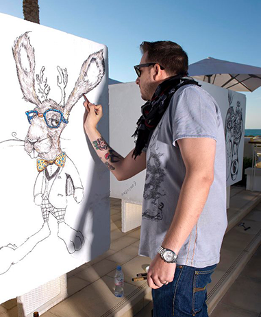 Matthew Ryder working live on artwork at Blue Marlin
