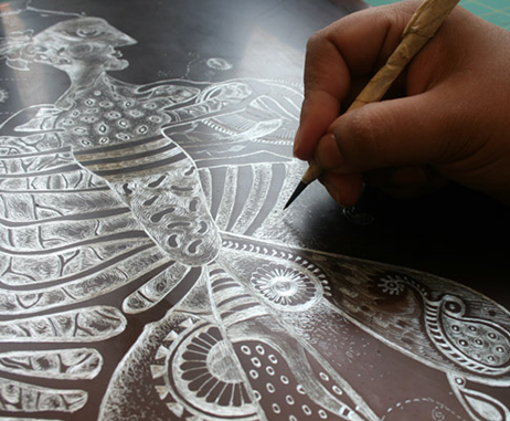 Nivedita etches her drawings ready for printmaking