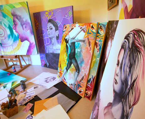Paintings by Perryhan El-Ashmawi in her studio