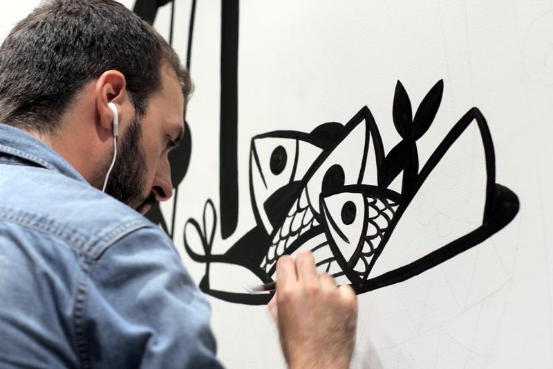 Artist Ruben Sanchez painting onsite at Salero