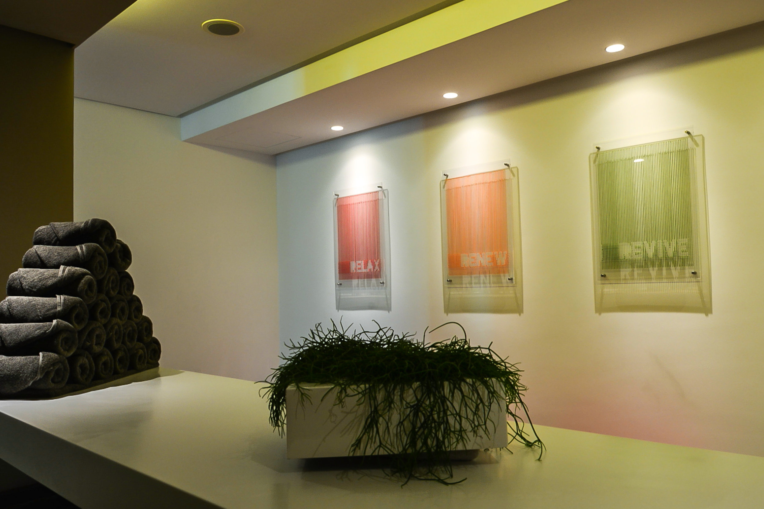 Relax, Renew, Revive on display in the spa at 72 by HUES