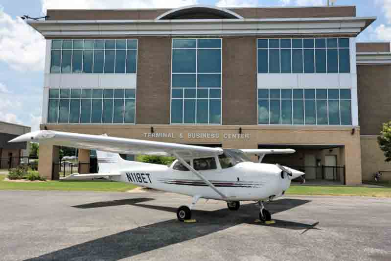 Copy of N118ET Plane parked in front of building complex