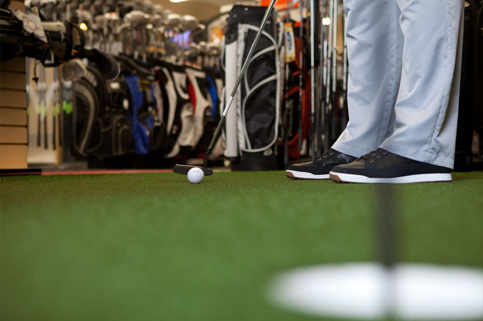 Indoor Putting Green - Not sure which putter you like? Test a number of our top of the line putters on indoor putting green and find the one that works best for your game.