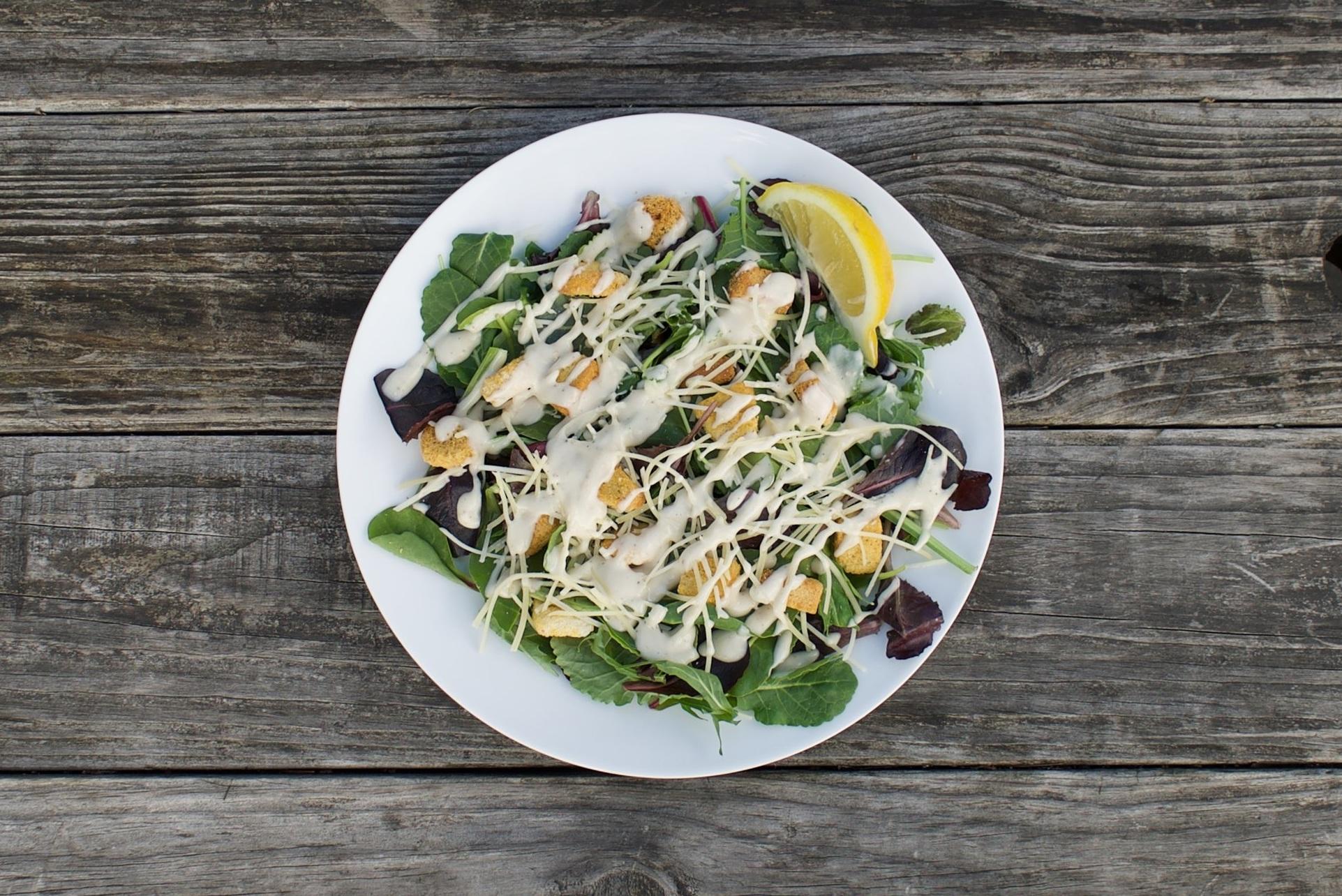 caesar salad. $7 - MIXED GREENS | CROUTONS | SHREDDED PARMESAN | FRESH LEMON | CAESAR DRESSING