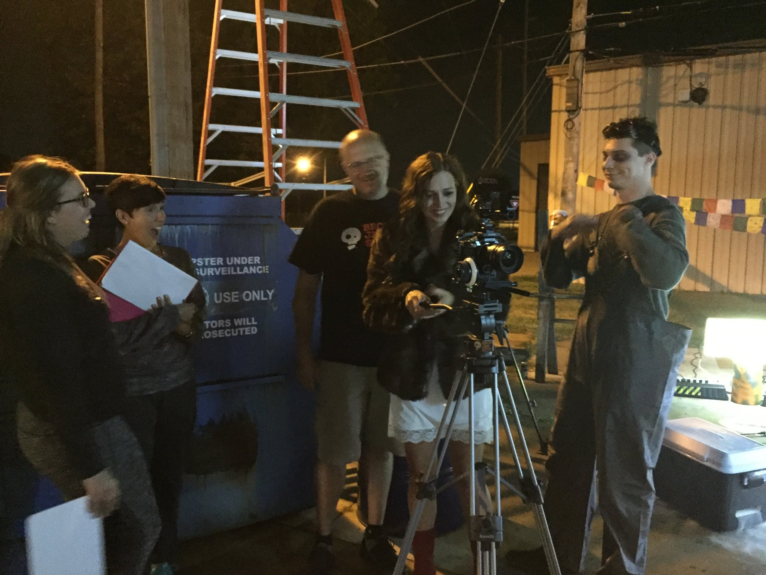 Some very happy Juice cast and crew reviewing a difficult shot.