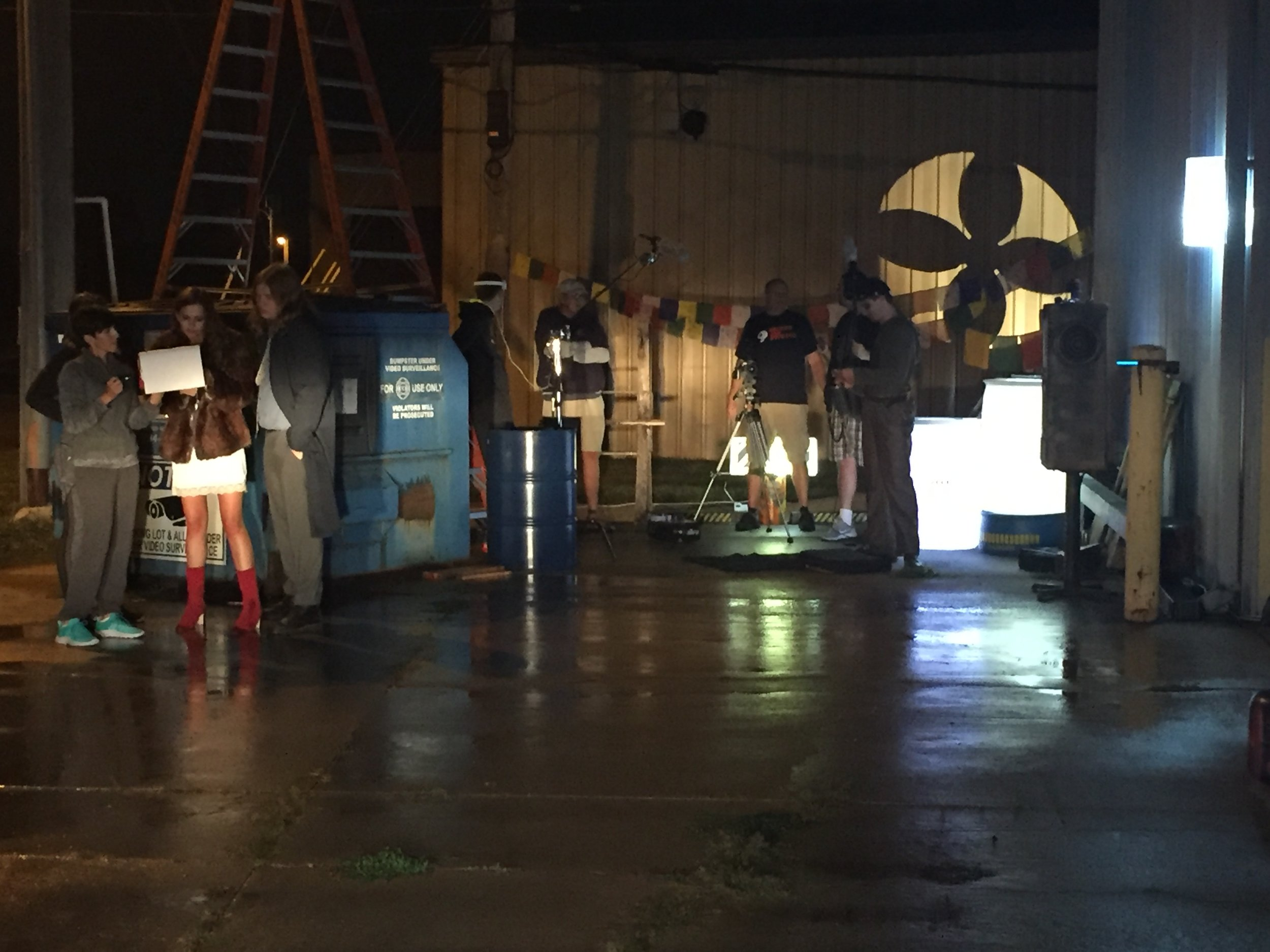Some of the Juice cast and crew on set. The Rotating Industrial Fan Projector Prop for Juice can be seen in the background.