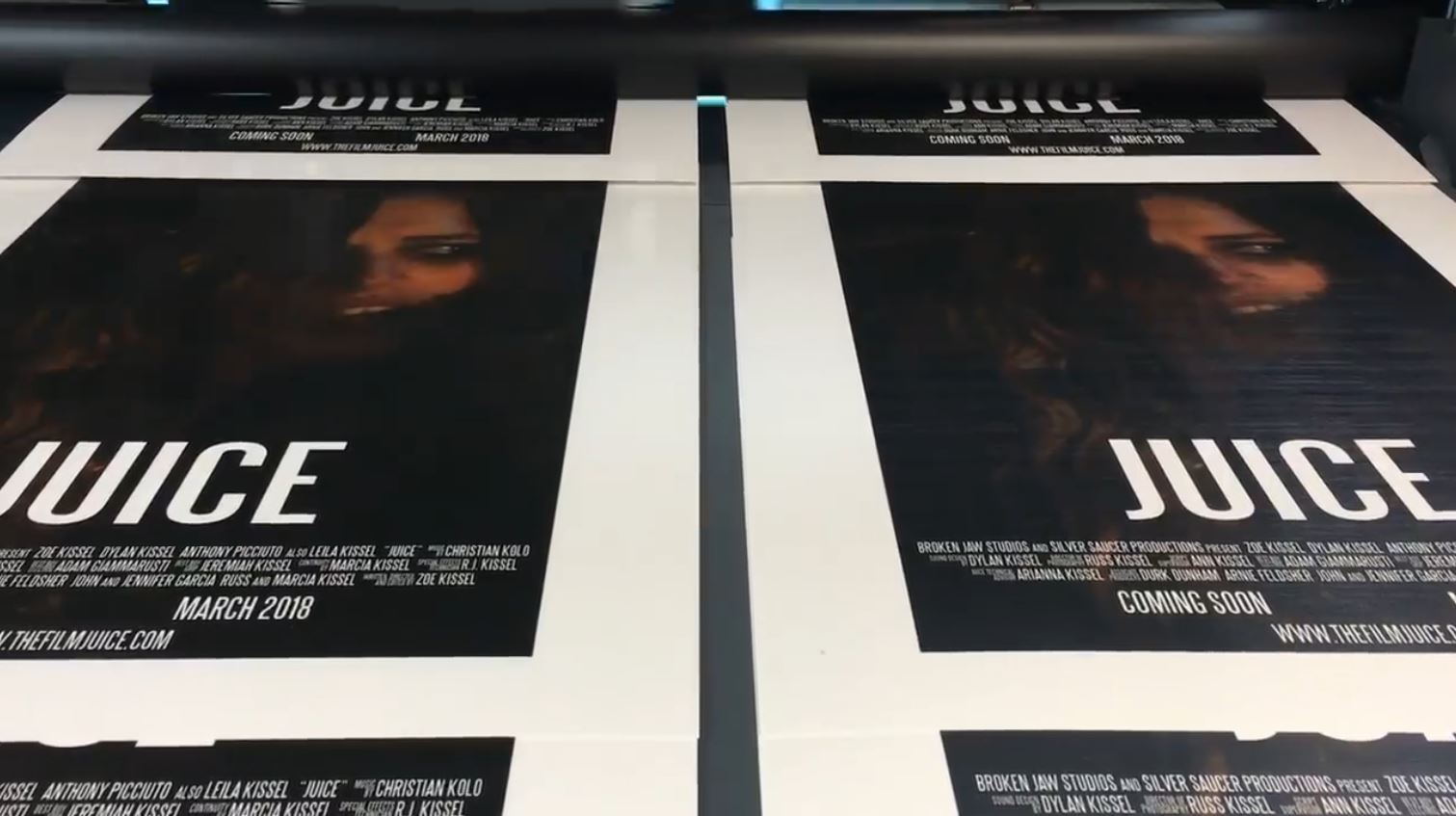 Official  Juice  posters in the process of being printed.