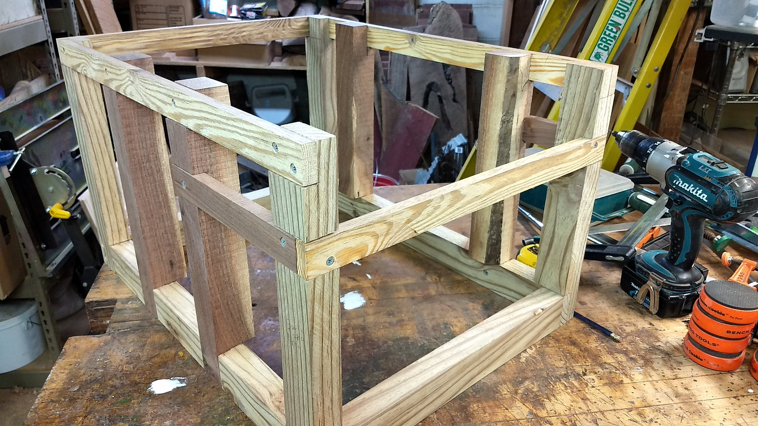 The posts and beams needed to strengthen the structure. The beams on the closest end will support a small shelf.