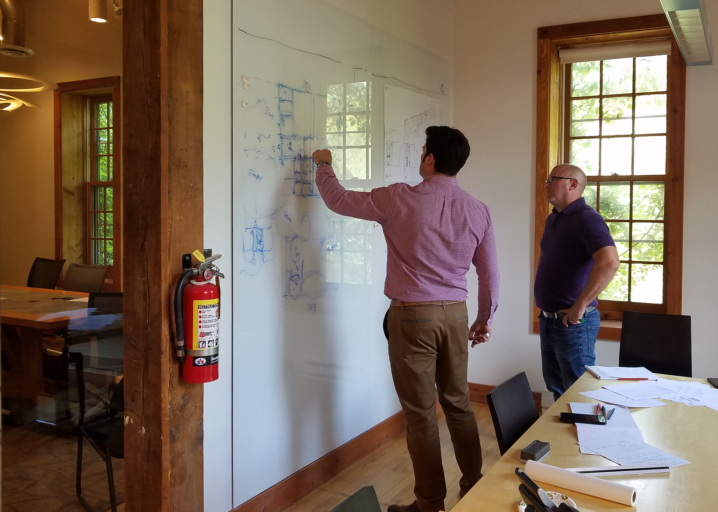 Peter (Director of Design) and Dan (Architect) collaborate to serve our clients.