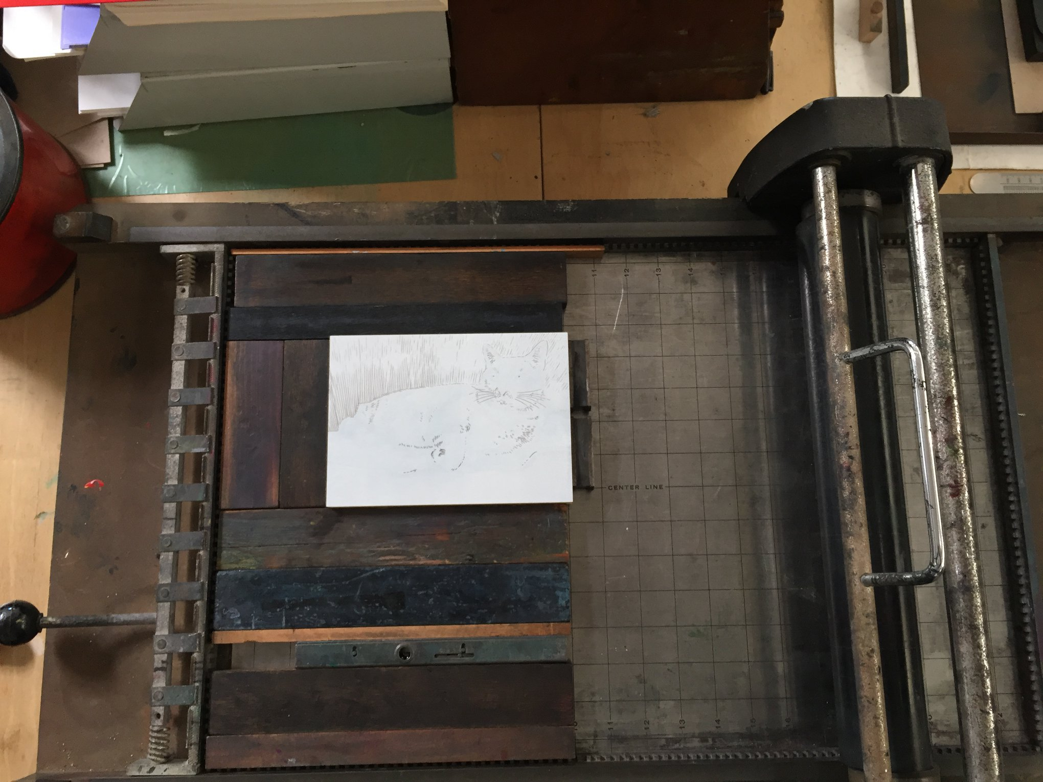Here is the block locked up in the press that I am using for the print. I am using a proofing press that we have at the Athenaeum's Print Studio.