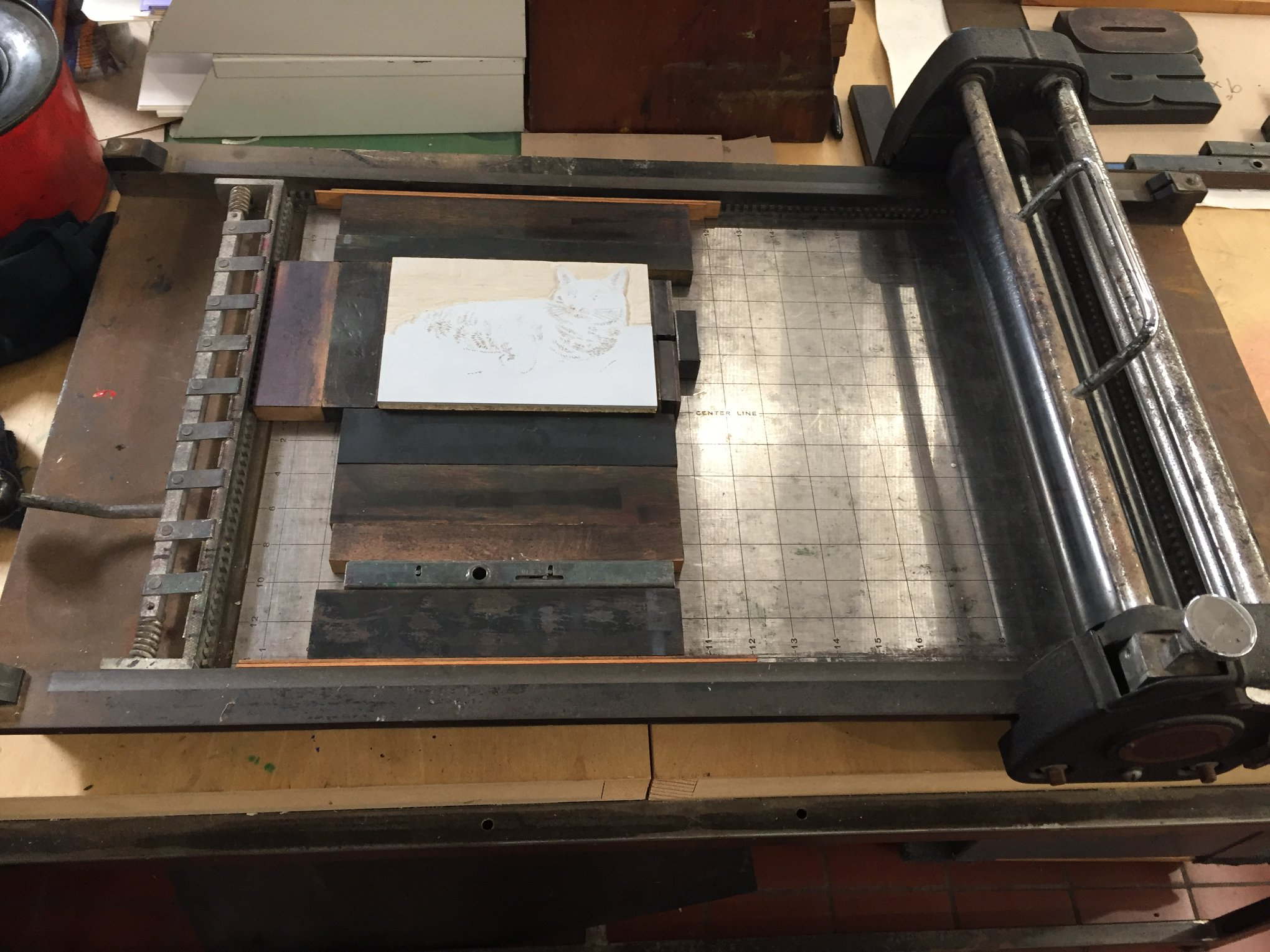Here is a photo showing the whole proofing press with the block locked up with wooden furniture and magnets.