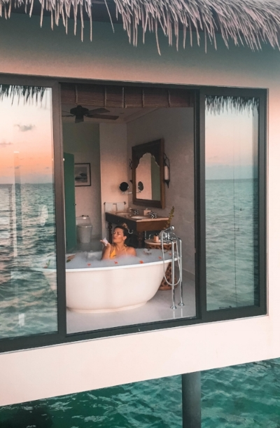 The bathtub in our room! Jeff is hanging off the balcony with my selfie stick to get this shot for me.
