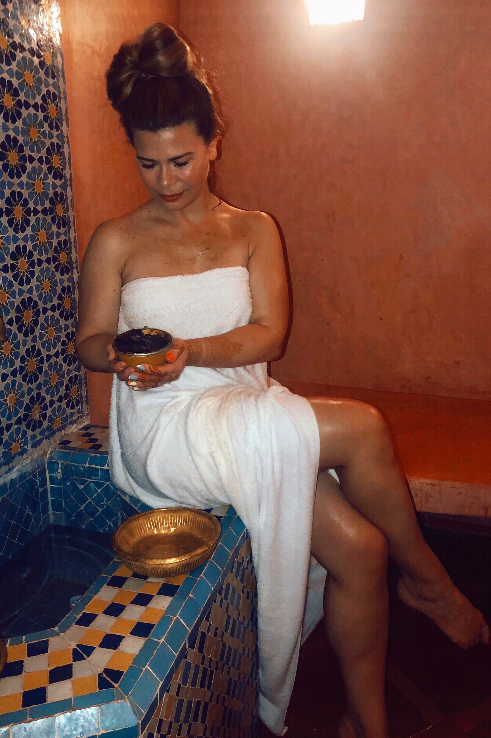 At a Hammam at the Es Saadi Hotel in Marrakesh. On my skin and in my hands is Beldi Soap - its softening our skin as we are (supposed to be) relaxing in the terracotta sauna.