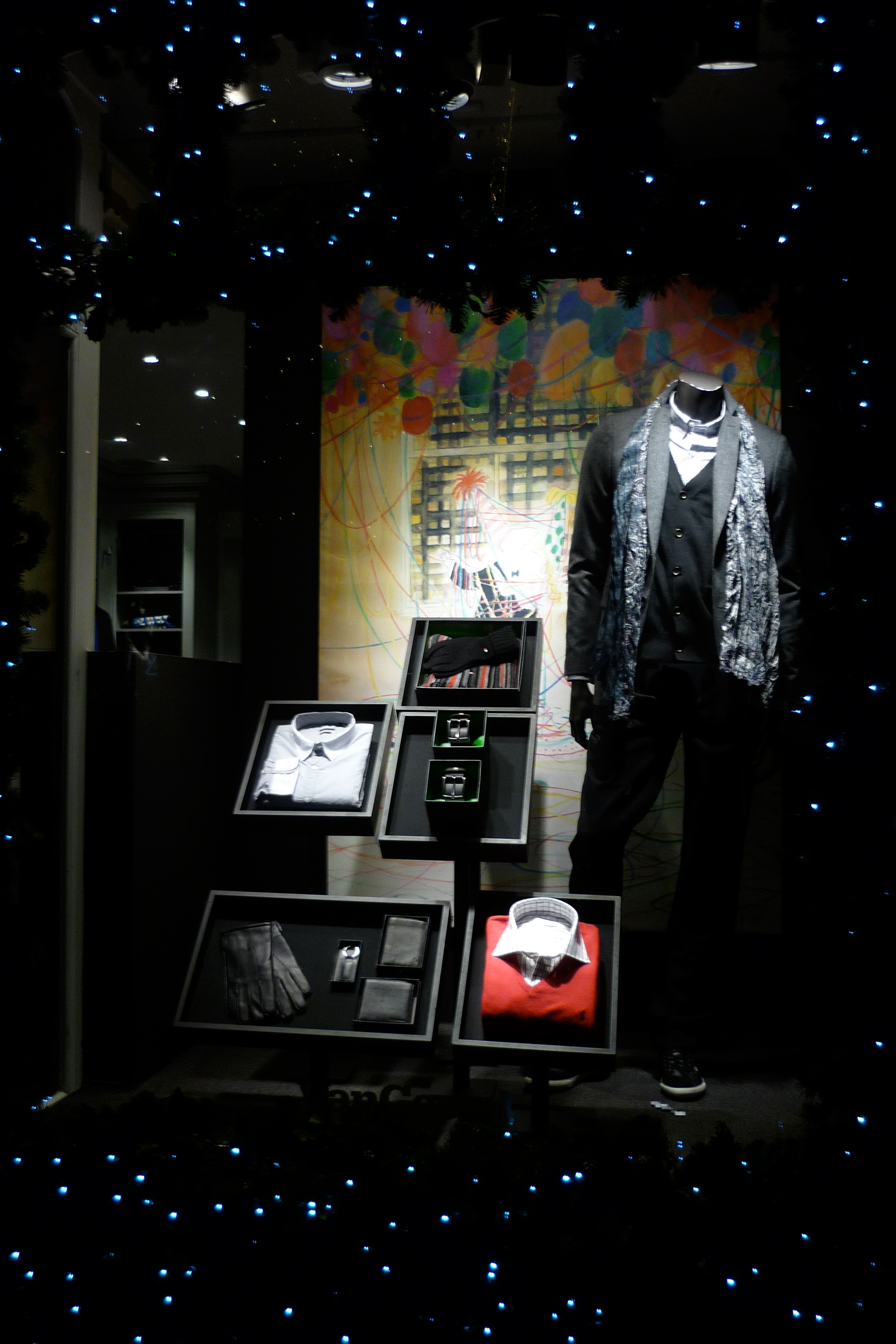 - New YearVan Gestelwindow A festive window was made for men's boutique Van Gestel. Lots of lights and custom made displays with a vintage newyear poster as a backdrop, set the scene.This made a classic newyear feel come to life.
