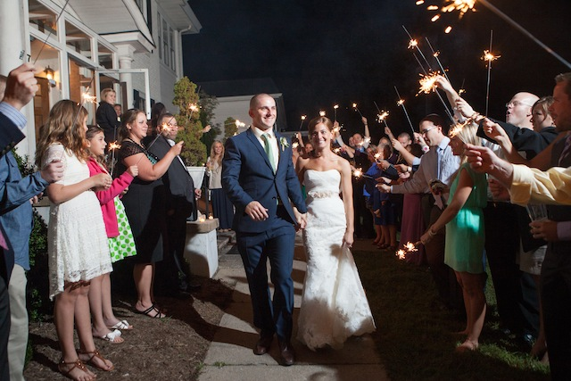 Sparklers lit the path to their new life together for the Mitchells. Photo by Laura's Focus Photography.