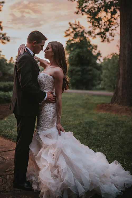 "This bride's stunning dress has more than a few details and embellishments for a ""WOW!"" factor.  Lindsay & Dennis Burch, page 36 of  bridebook  2019. Image by Audrey Ruth Photography."
