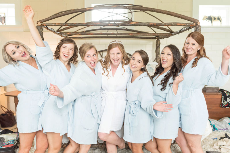 Bride Kayla with her best girls. Dancing, singing and being silly together is a surefire way to de-stress! The Fuller-Willis wedding, page 56 of bridebook 2019. Image by Lindsay Rickards.