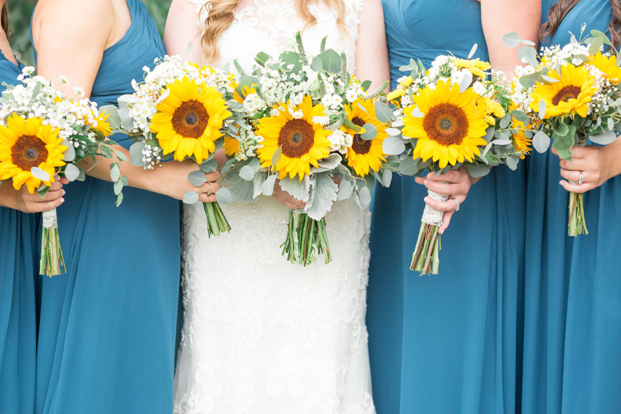 Bride Kayla chose sunflowers to add a little pop of color to her bouquet. Fuller-Willis Wedding, page 57 of bridebook 2019. Image by Lindsey Rickards Photography.