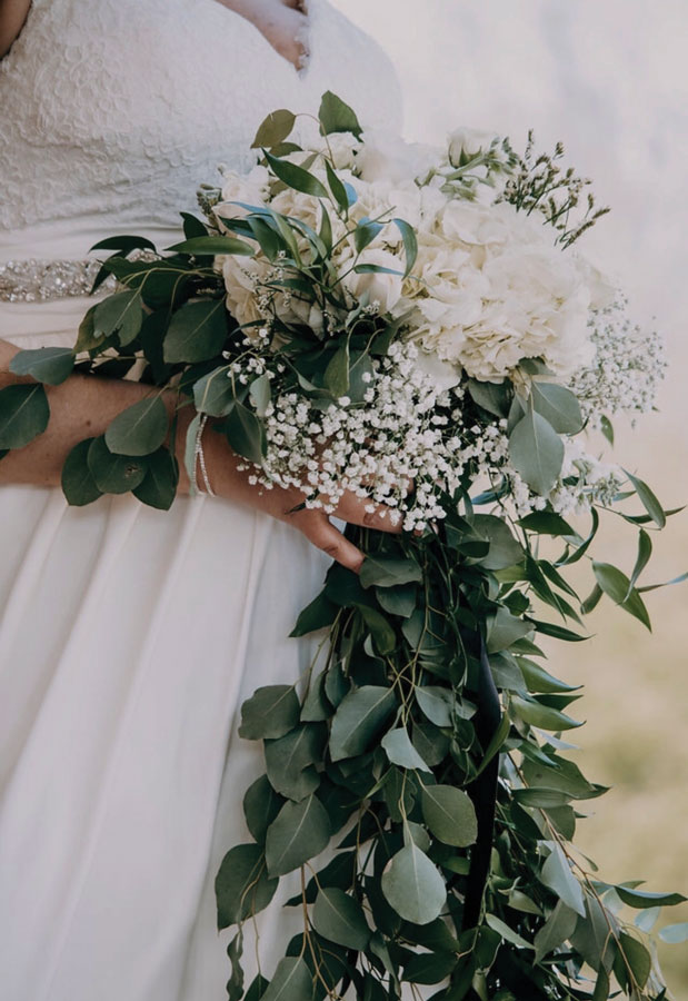 Baby's breath is the perfect filler flower to add a little extra dimension to any wedding arrangement. The Byrd-Gray Wedding, page 28 of bridebook 2019. Image by Elizabeth Harris Photography.