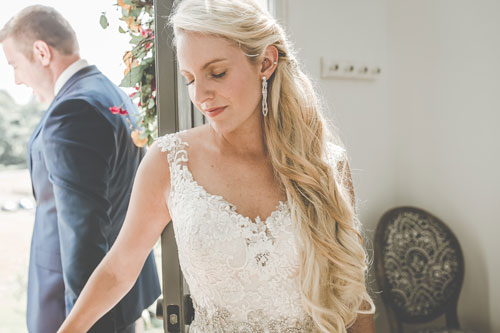 These diamond statement earrings complemented bride Bri's lace wedding gown and beaded belt. The Eades-Swarm Wedding, page 66 of bridebook 2019. Image by Olivia Diane Photography.
