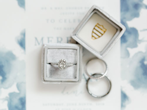 Bride Meredith's stunning engagement ring features an oval-shaped statement gem and diamond-studded microband. The Brammer-Patterson Wedding, page 44 of bridebook 2019. Image by Meredith Sledge Photography.