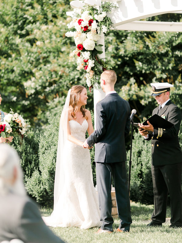 Bride Meredith and groom Logan opted for a short and sweet summer ceremony surrounded by all of their family and friends. Brammer-Patterson Wedding, page 44 of bridebook 2019. Image by Meredith Sledge Photography.