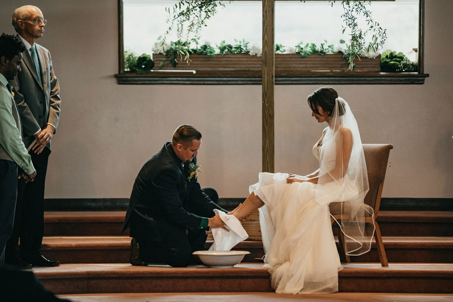 In addition to writing their own vows, bride Carley and groom Chris included a traditional foot washing ceremony to symbolize their devotion to one another. Edwards-Beckner Wedding, page 42 of bridebook 2019. Image by Pat Cori Photography.