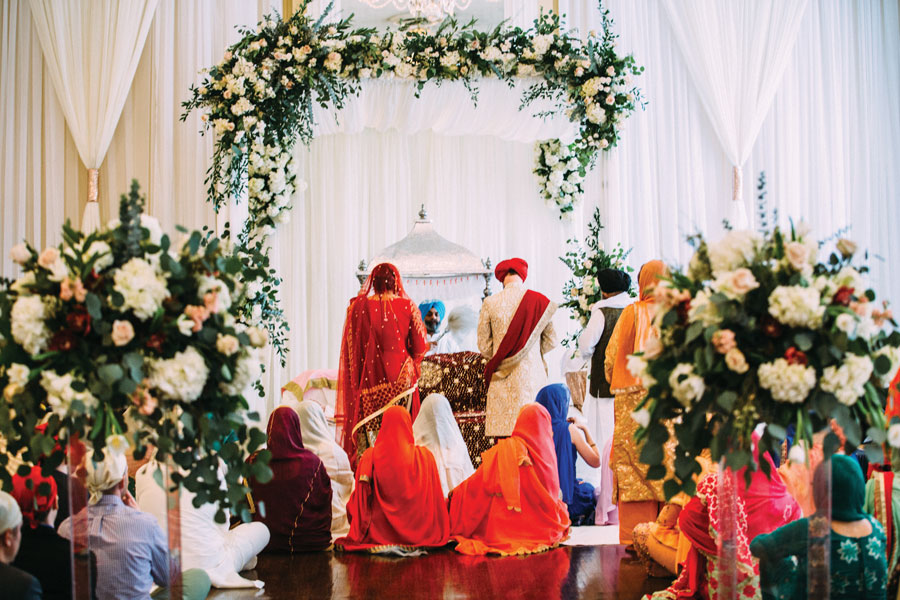 This stunning Sikh wedding ceremony was one of two for bride Ruby and groom Jacob. Sandhu-Andrews Wedding, page 64 of bridebook 2019. Image by Jared Ladia Photography.