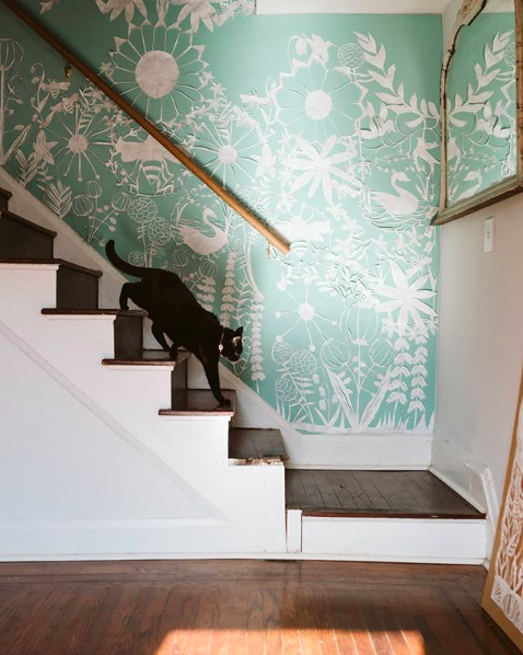 Large scale papercut up the stairs in Annie's studio