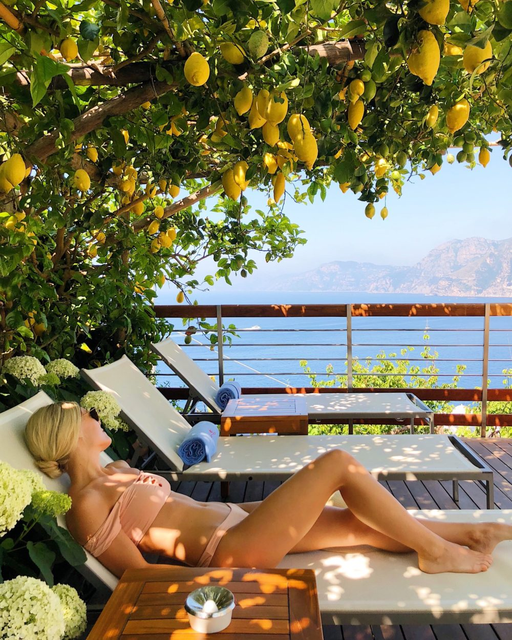 LOUNGING UNDER THE LEMON TREE AT CASA ANGELINA IN PRAIANO, ITALY