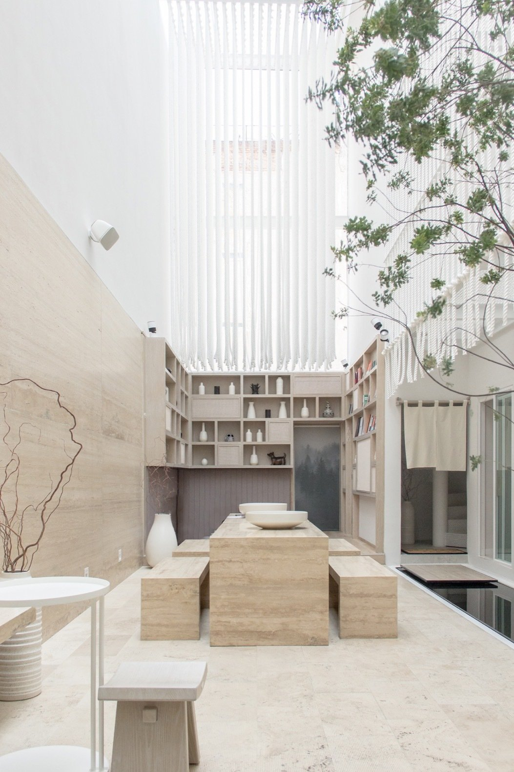 the-light-filled-welcome-area-features-an-open-library-seating-and-a-zen-garden.jpg