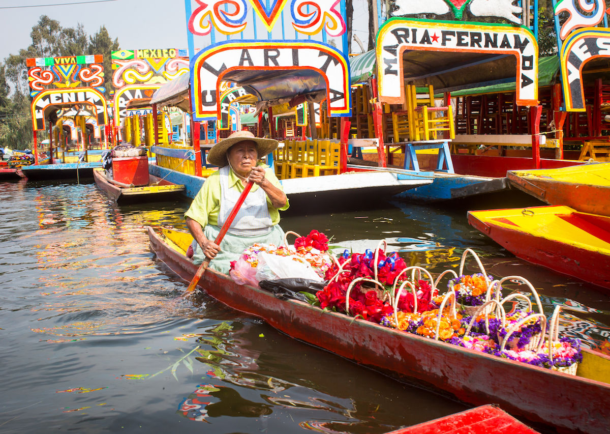 Small-boat-filled-with-flowers-in-Xochimilco-Mexico-City-1200x853.jpg