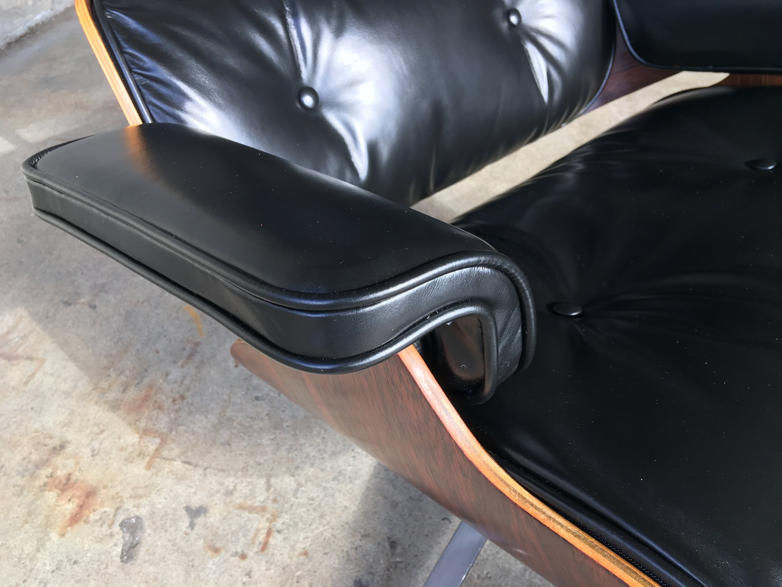 New leather arms on and Eames Lounge