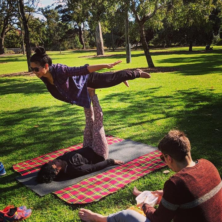 Wendy Flying in the park, acrojam partner yoga style