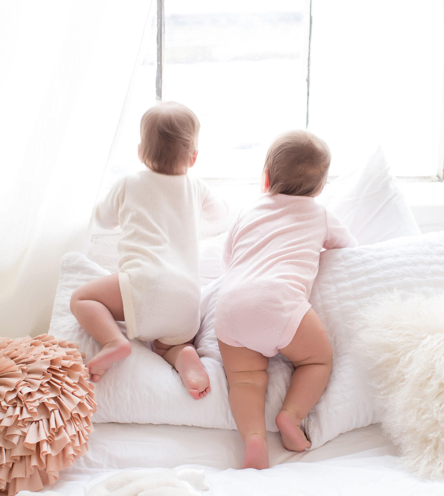 6 month baby studio portraits of twins in onesies